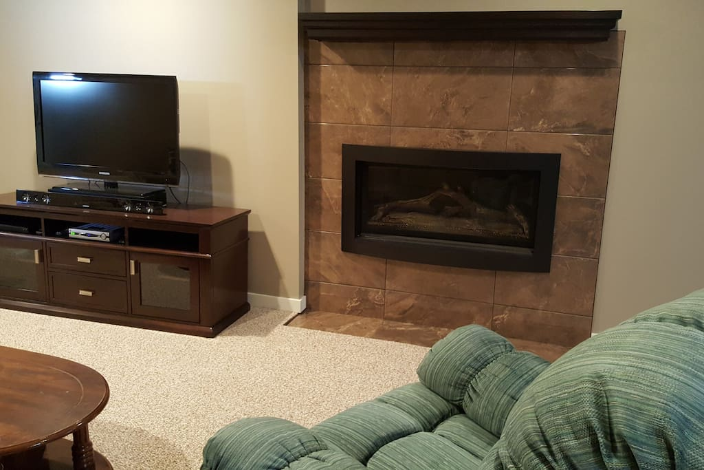 "Thermostat controlled gas fireplace and 40"" smart TV"