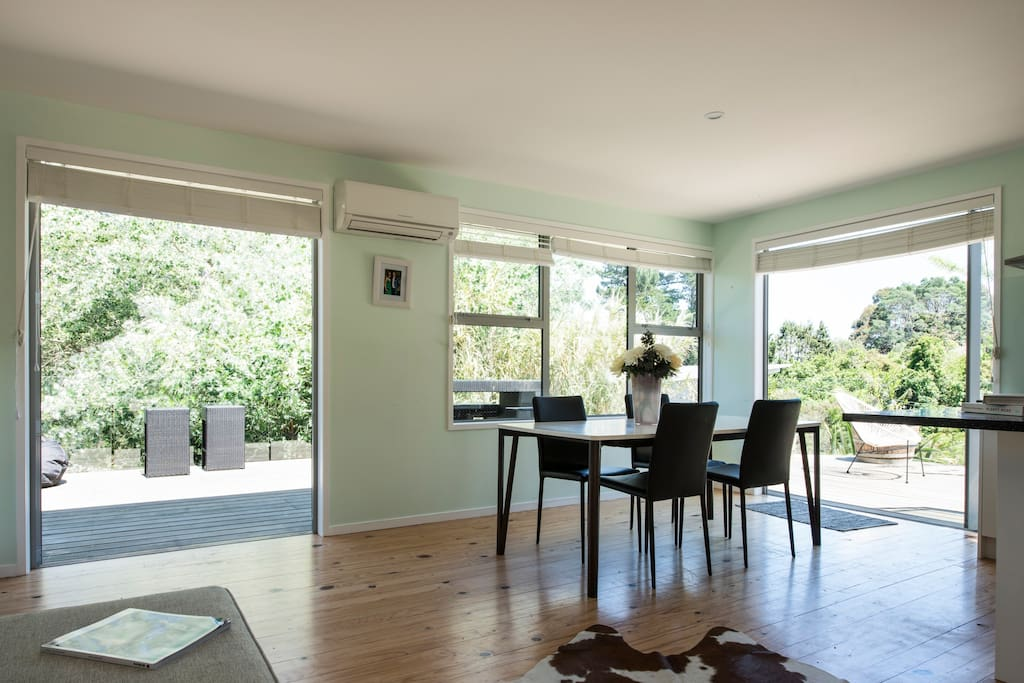 Open plan lounge, dining room and kitchen which opens out onto the spacious deck