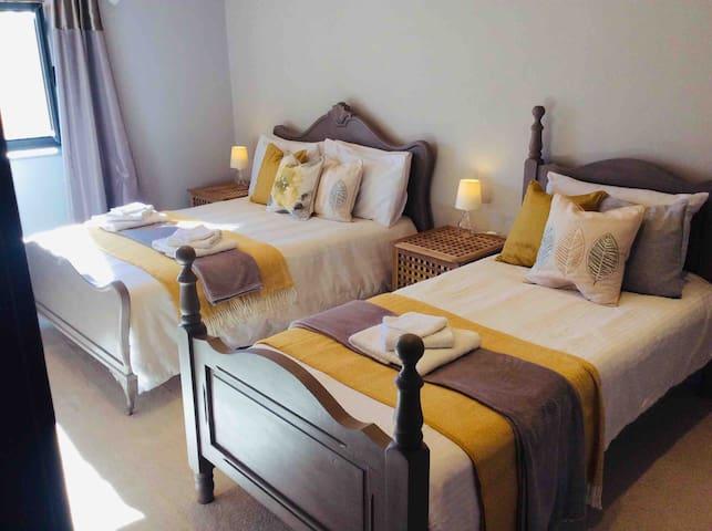 Honey room with double and 2 single beds sleeps 4