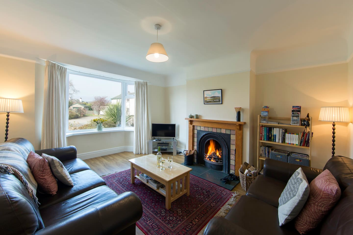 The warm, welcoming front sitting room with roaring log fire