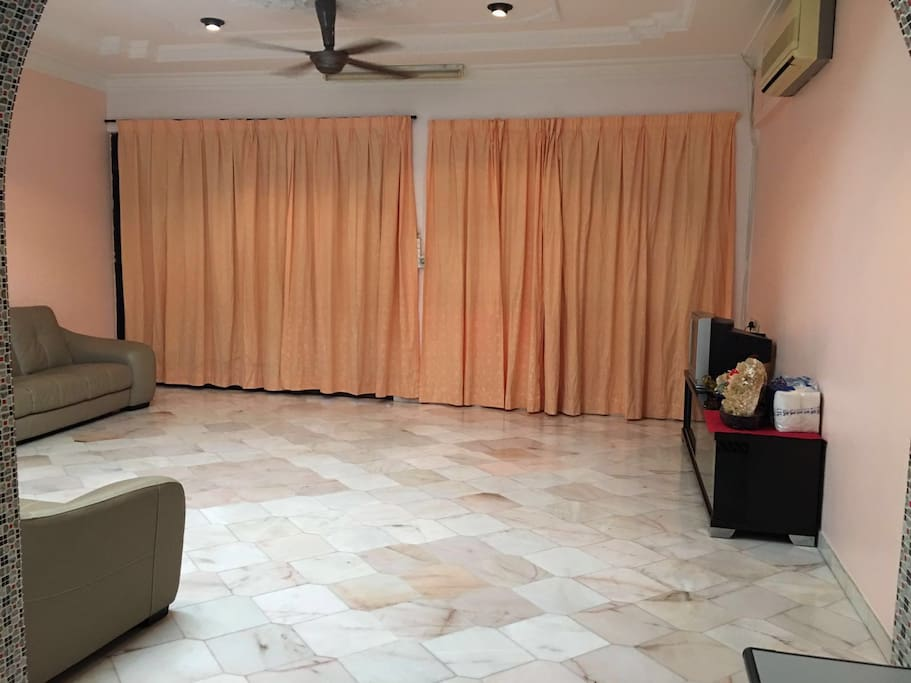 Here are the spacious living hall with air conditioning and Astro TV Channel