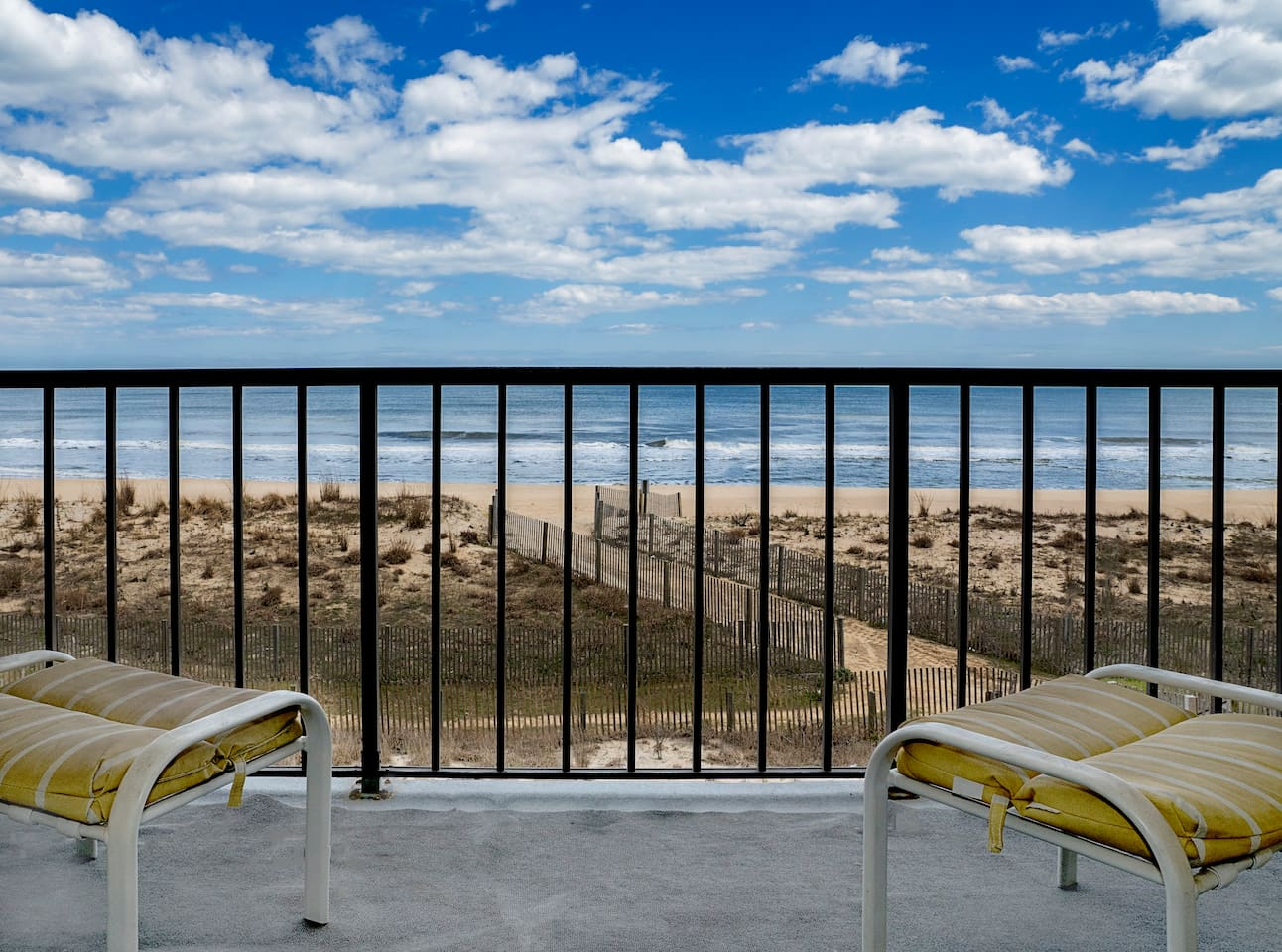 The view of the Atlantic Ocean, dunes, and low-population beach from the unit's private balcony.
