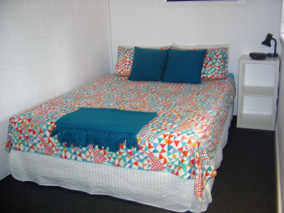 Clean comfy bed with quality linen. Air conditioned