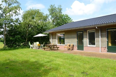 Holiday home with en-suite bathrooms, view over the meadows, near forests