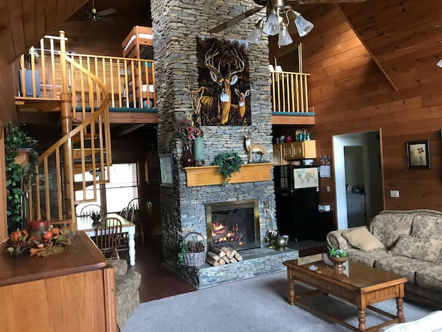 During the winter months, the warm fireplace provides a warm atmosphere where families and friends gather. The firewood is located outside the back door, and there is plenty of kindling outside near the woods as well.