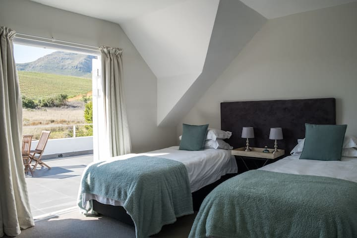 Bedroom leading onto patio with twin beds