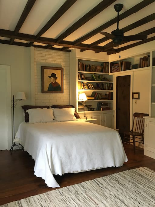"""master  ground floor bedroom """"the library"""" with queen bed and newly renovated bath"""