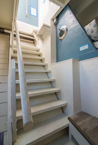 Stairway to deck with sweeping 360 degree view of the sparkling ocean and harbor.