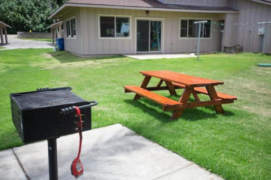 After a day at the beach, relax in the grass yard and throw dinner on the grill.