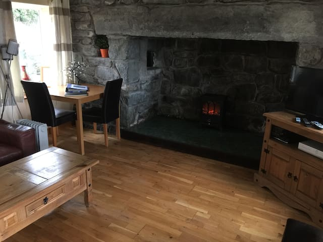 Flatscrean tv, this is not a log fire, but we have sea views.