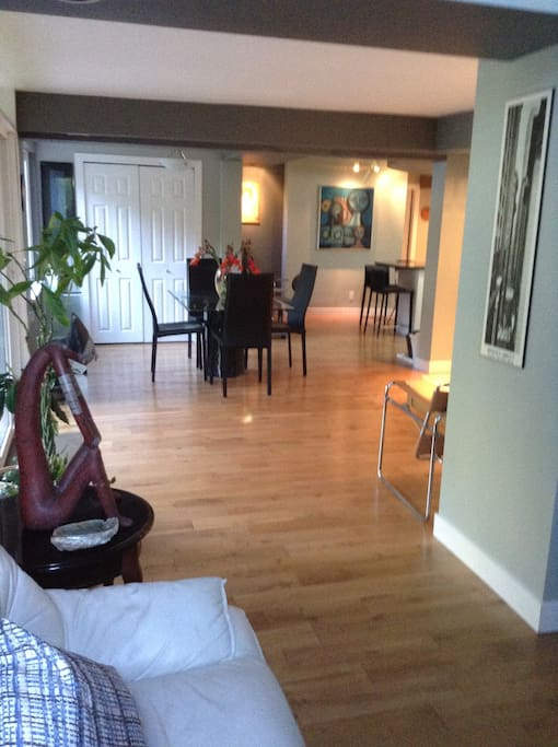 Dining room. View from the living room towards the lobby, dining room, kitchen.