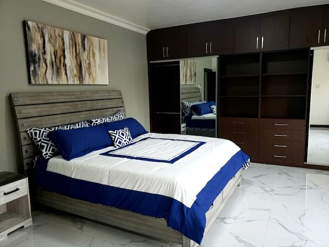 Master Bedroom with king sized bed, copious amounts of closet space and en-suite bathroom