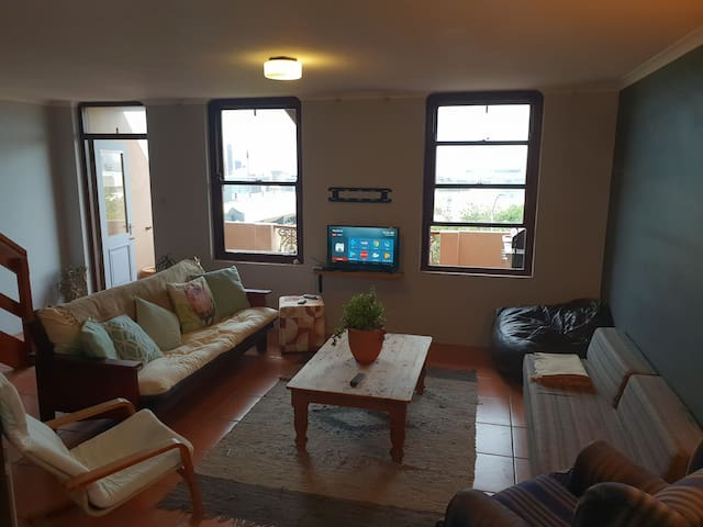 Living room with City views and access to balcony