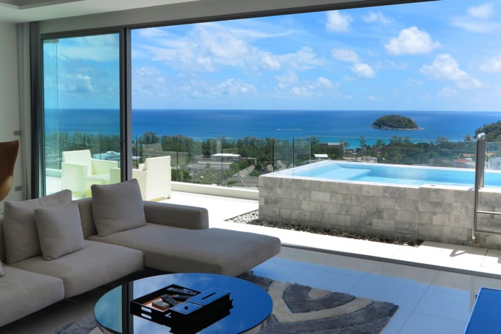Enjoy the stunning view of the ocean while you relax in the private jacuzzi
