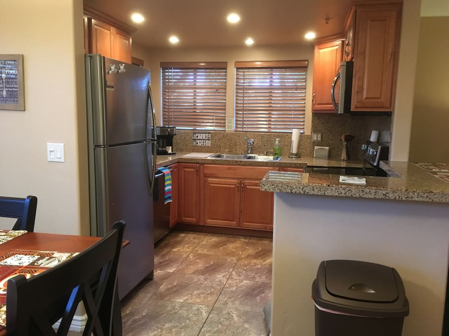 Kitchen fully stocked with stainless steel appliances