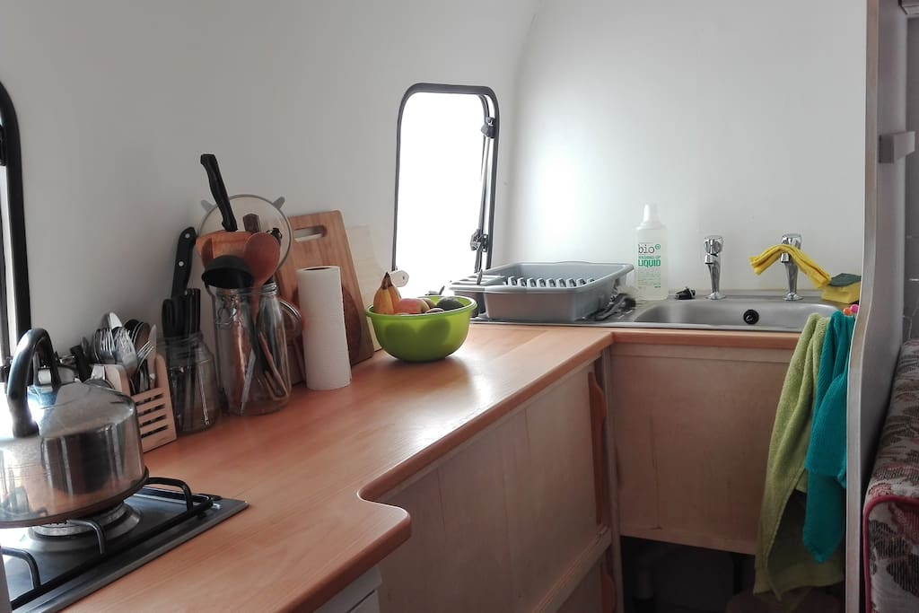 Kitchen with custom beech worktop, 2 hobs, full size fridge and full size sink/drainer