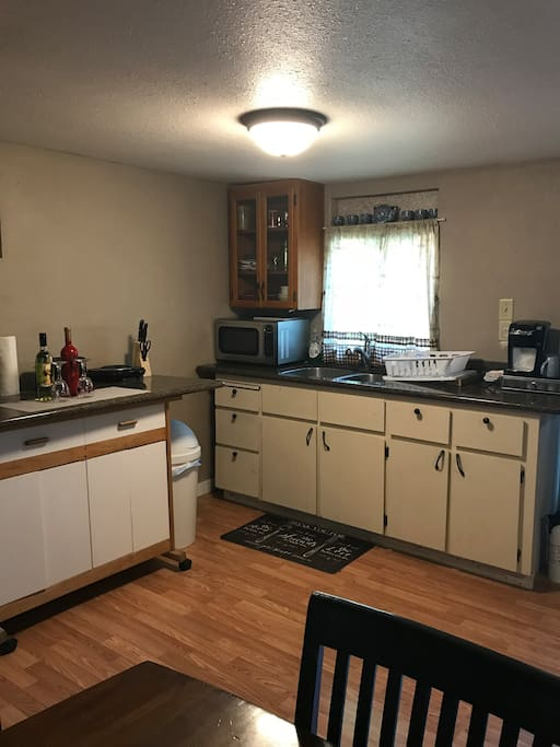 Kitchenette with granite counters, full sink, full size fridge, microwave, and single burner hot plate. All dishes, silverware, and basic cookware provided. Keurig and assortment of coffees also supplied for guests.