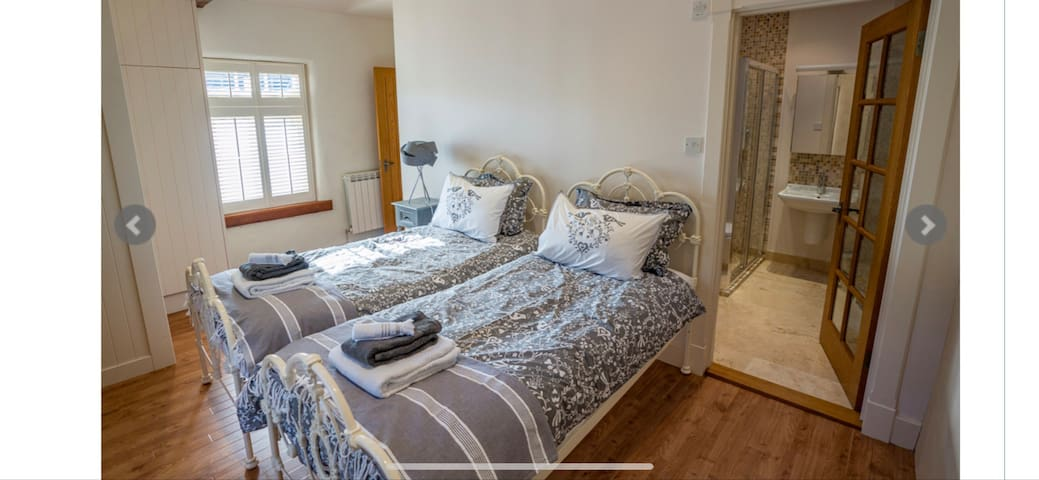 Bedroom 3 has twin beds and has access to its own en-suite shower room.