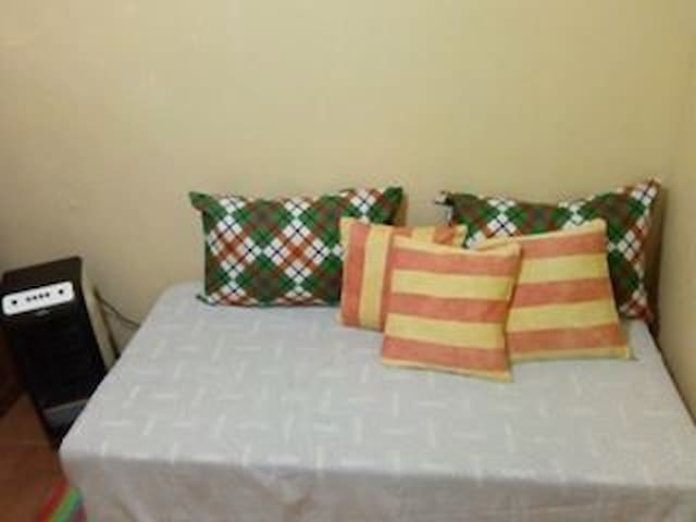 Fatima Room: Ideal for  1 to 2 persons, fully air-conditioned, with WiFi, spacious cabinet, table & chair.