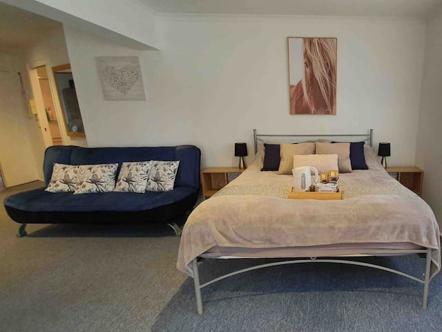 Comfy queen bed and sofa bed  (two single mattresses available too)