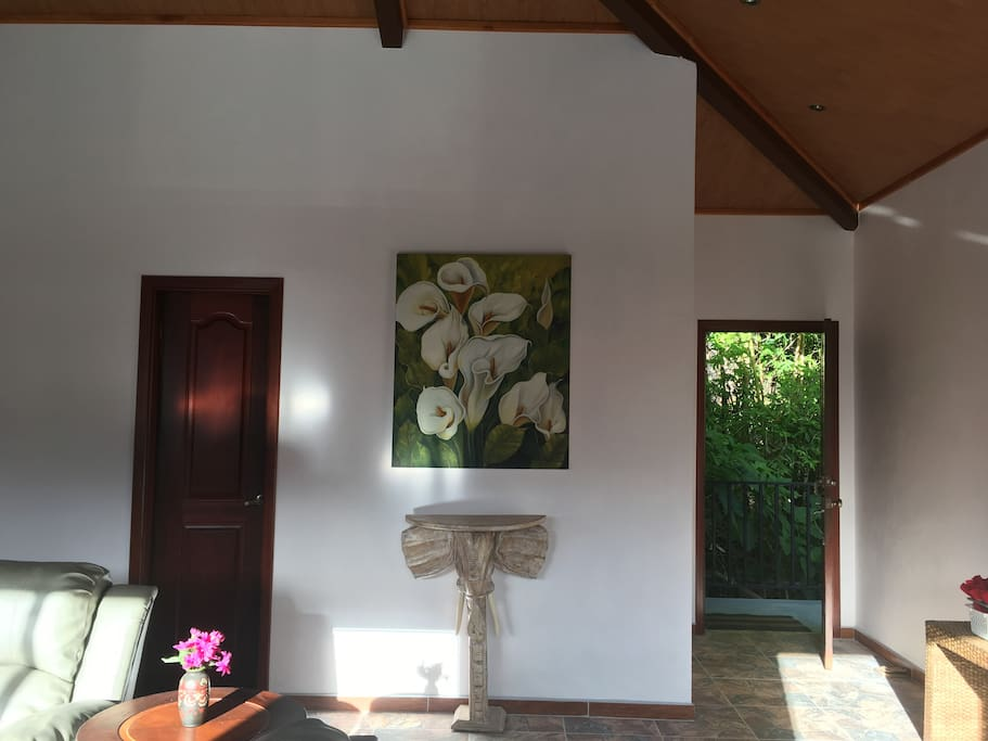 This is private entrance that leads to the opening foyer.  There is a bamboo stand immediately outside your door and a stream just behind it.  Attractive art fills the condo.