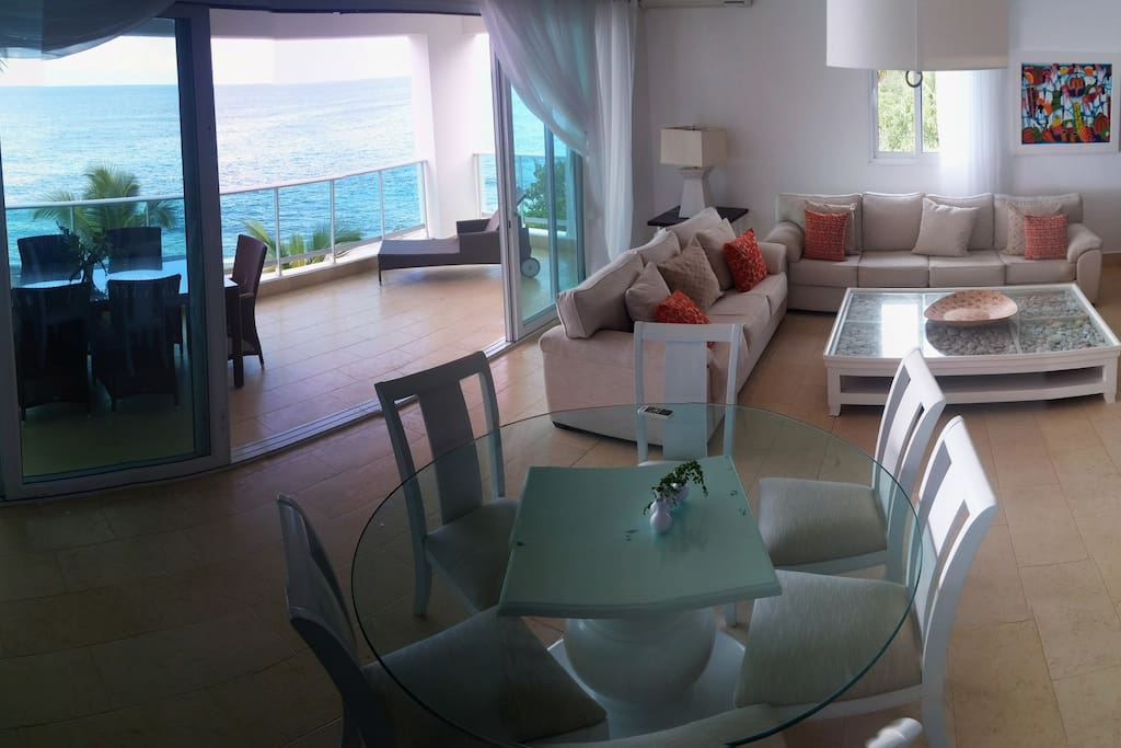 Open Concept with Sea View - Living Room, Dining Room, Kitchen and Balcony.