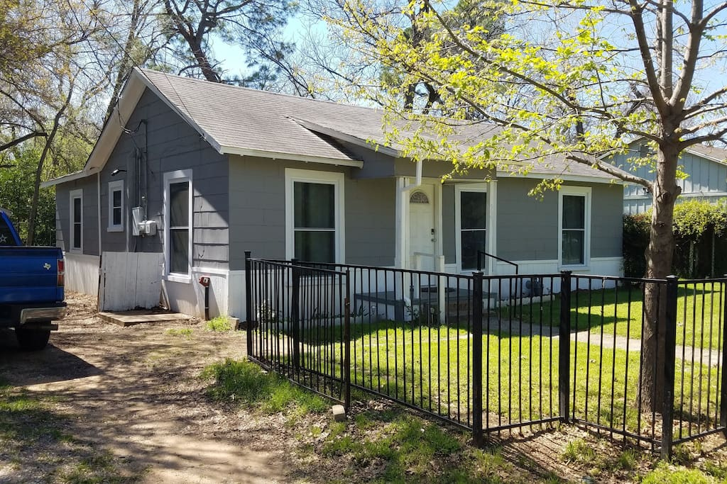 This rustic home in an established neighborhood features a large yard with shade trees in the back.  New windows were recently installed. And, it offers ample parking close to AT&T Stadium.
