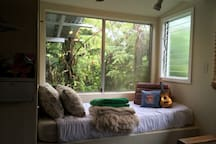 A place to read a book, with a view of the anthuriums. Extra sleeping area for friends or great for children too!