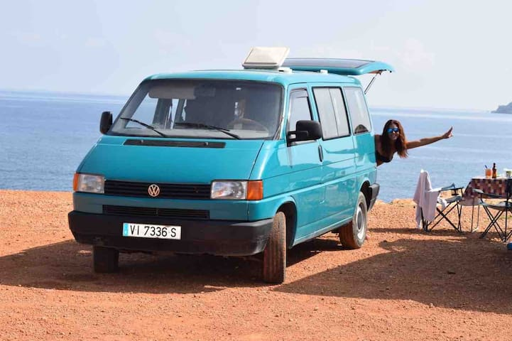 Discover Ibiza in a rustic van and a paddle surf