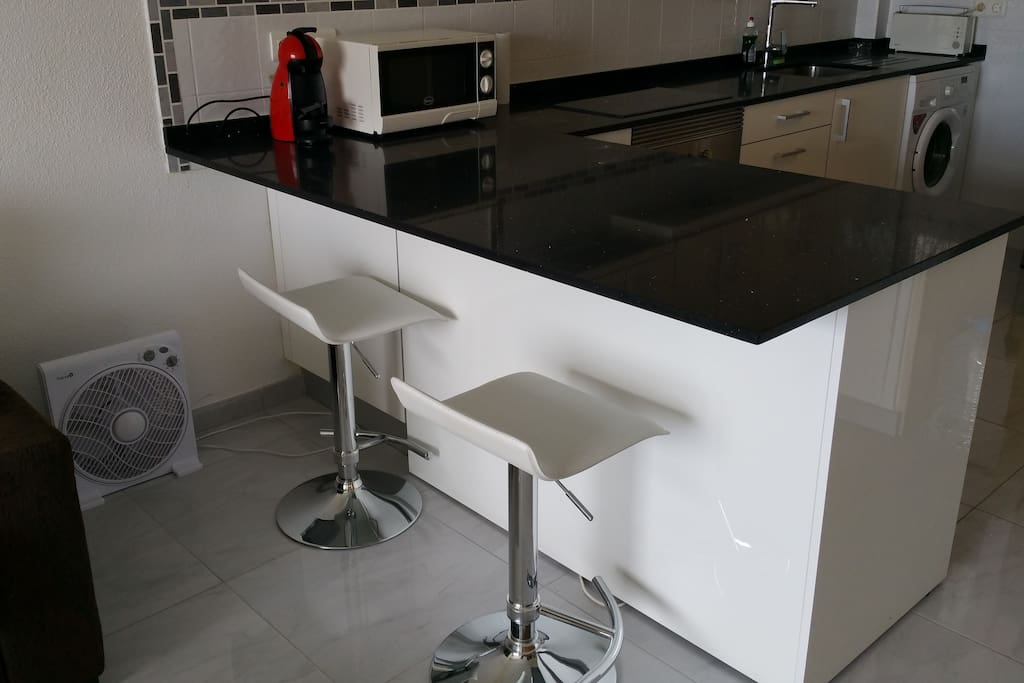 Breakfast bar with Fridge and Freezer behind in the kitchen side