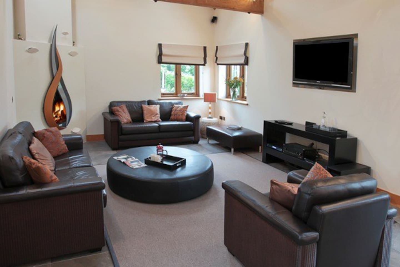 Beautiful lounge area with bespoke wood burning fire