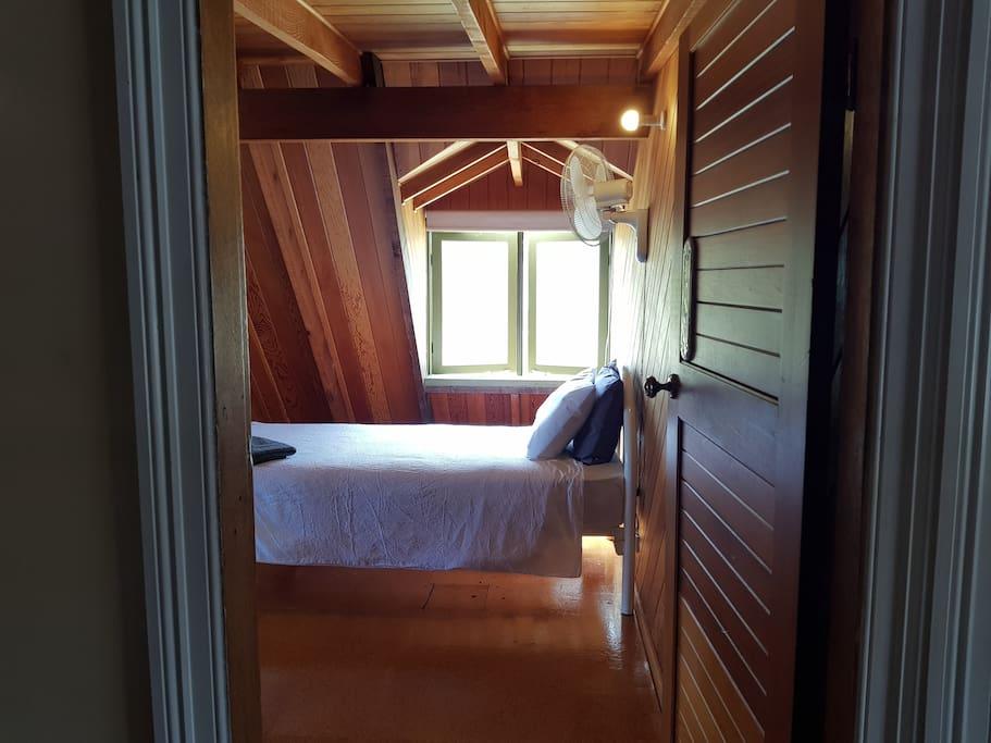 Bedroom 2 Mostly Cedar 1 x Queen Bed  1 x Single Bed