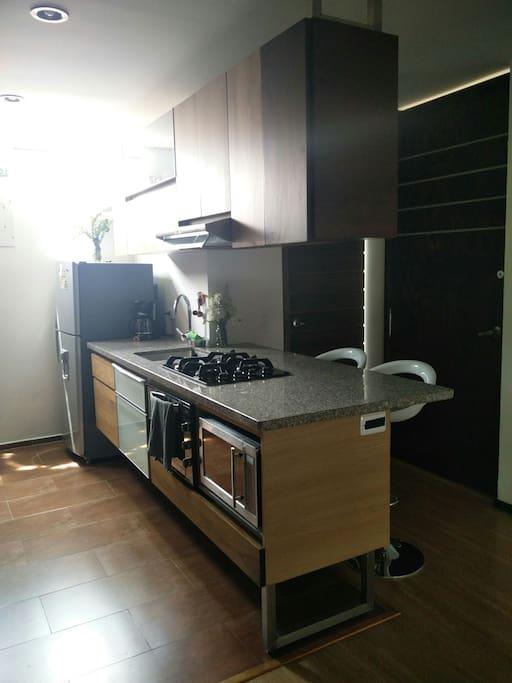 Kitchen with 1/2 bathroom.