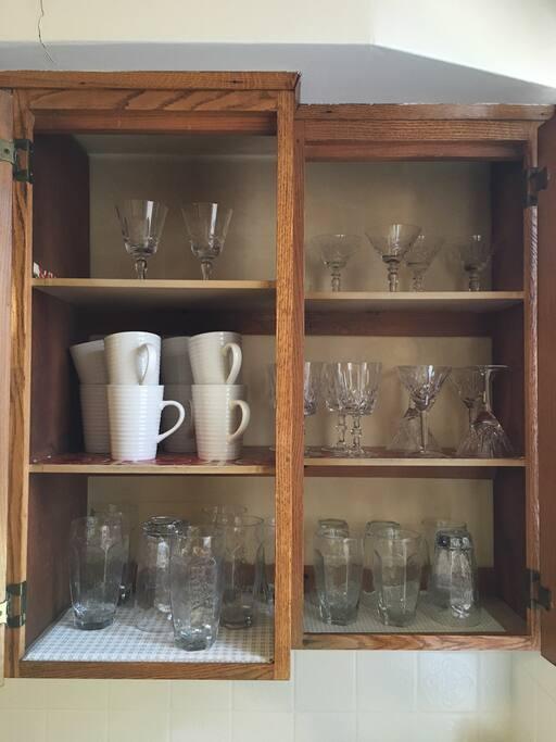 Stocked glassware in kitchen.
