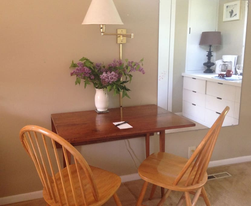 Small table in room serves as a nice indoor space to dine or work