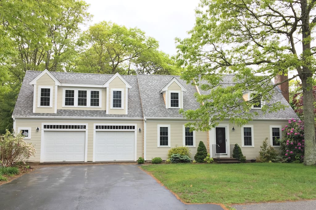 Traditional Cape with new 2 car garage, windows, siding, and roof.