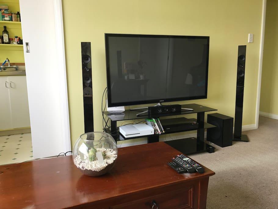 Flatscreen smart tv with surround speakers