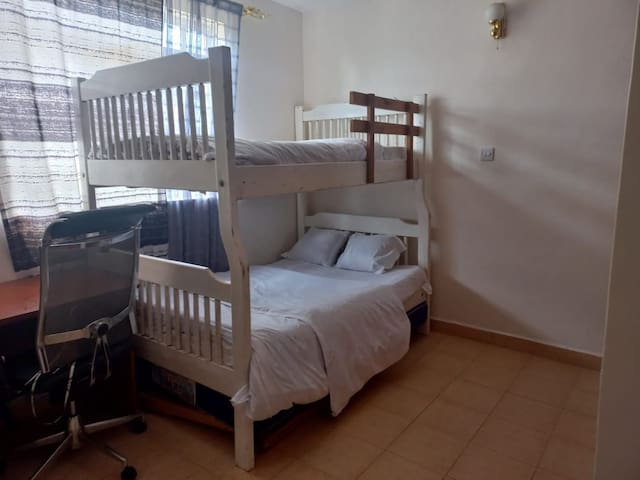 The second bedroom has a double bed,  a work area and an all ensuite bathroom toilet. It can comfortably sleep three
