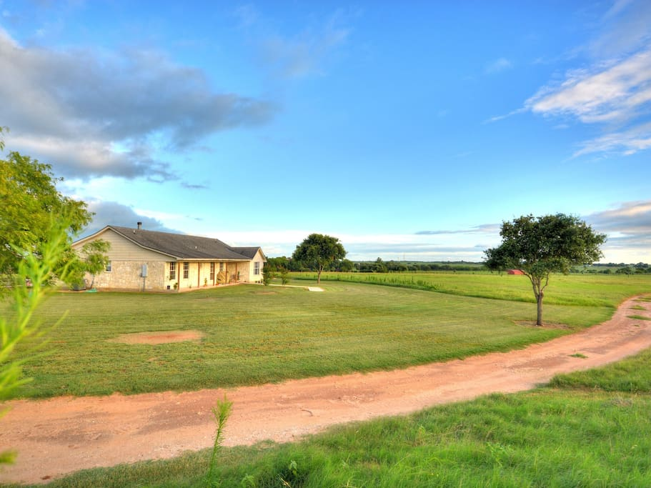 Ranchette house overlooks hay fields and horses grazing