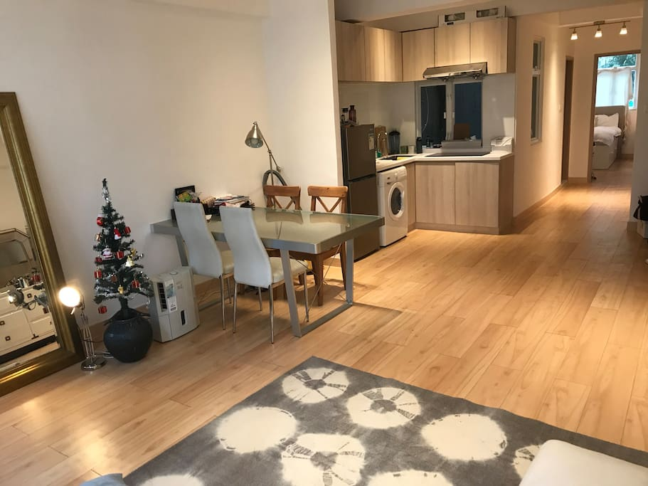 Open dining area with washing machine, dehumidifier, and fully equipped kitchen