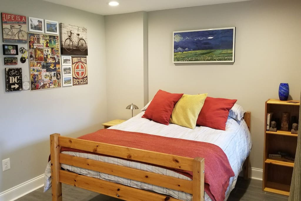 Private bedroom with full bed and bicycle-themed collage wall!