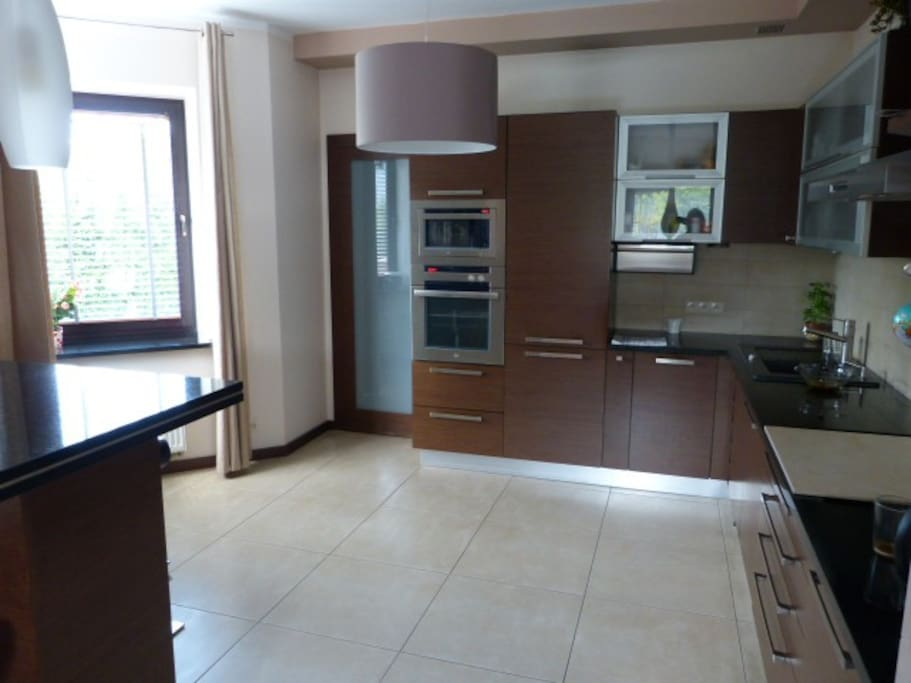 fully equipped kitchen: oven, microwave, dishwasher, plates, cutlery, glasses