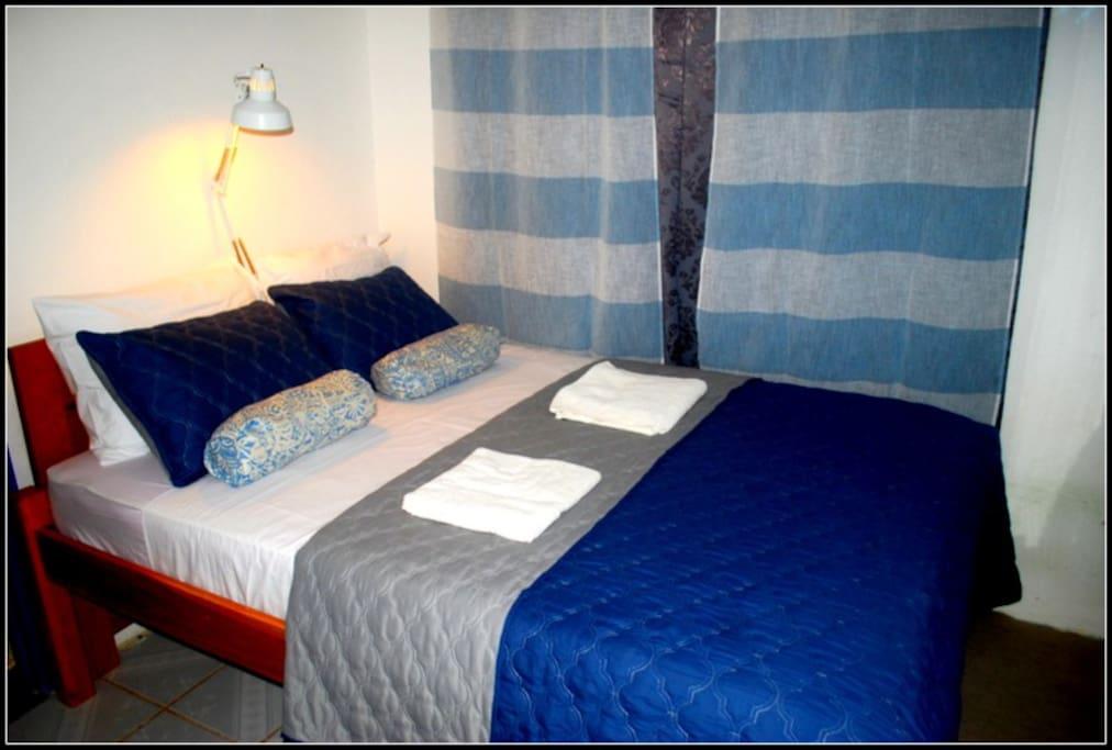 New mattress and crisp clean white linen.