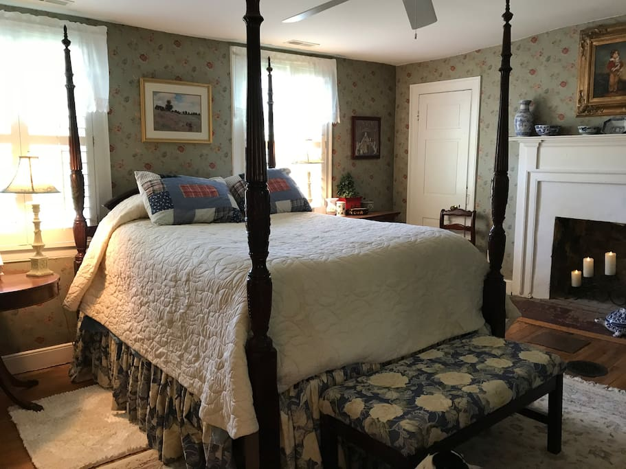 Guest Room 2 with queen bed with direct access to bathroom.