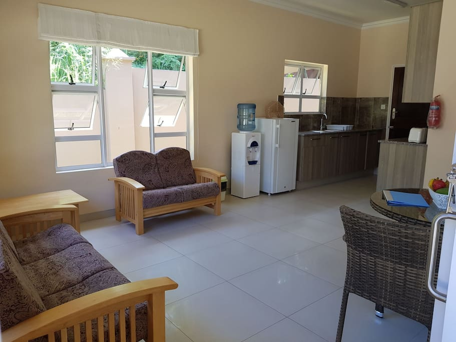 spacious lounge leading to your kitchen