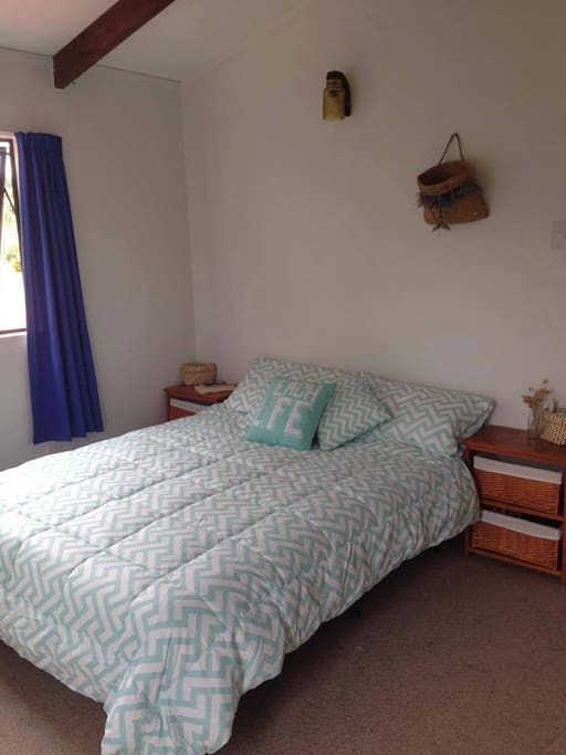 The Beach House upstairs double bedroom with Cot available on request