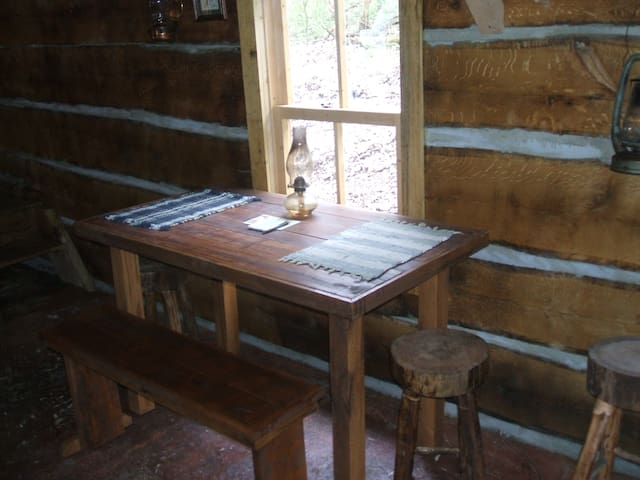 A handmade table, benches and stools offer ample seating for meals.