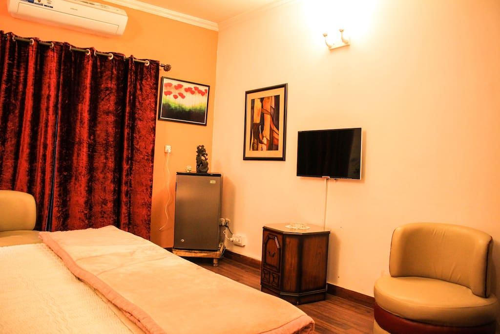 Fridge , Flat Screen TV , Seating Coach Double Deluxe Bedroom With Balcony