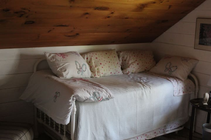 Bedroom 2 - day bed, with trundle.  Overlooks pond