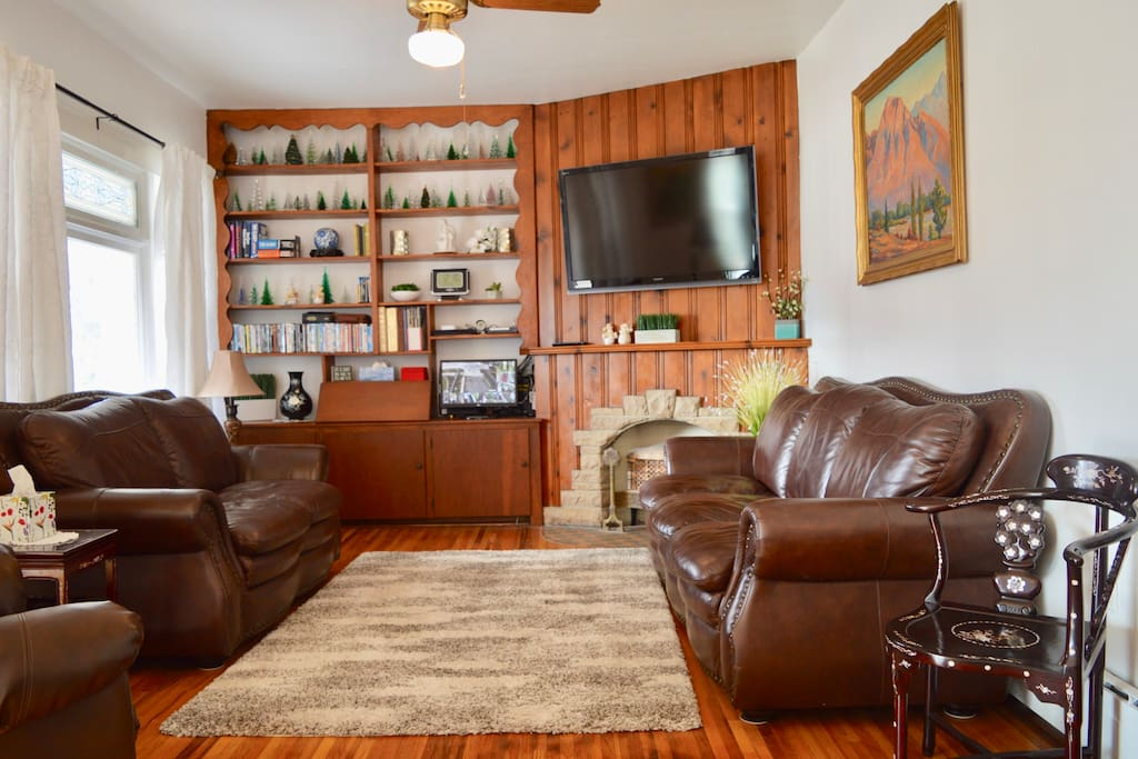 Relaxing Den with Ceiling Fan and Leather Couches and Recliner